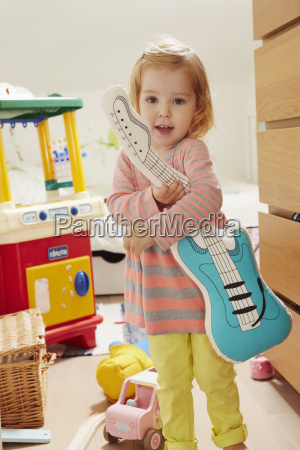portrait of female toddler in playroom