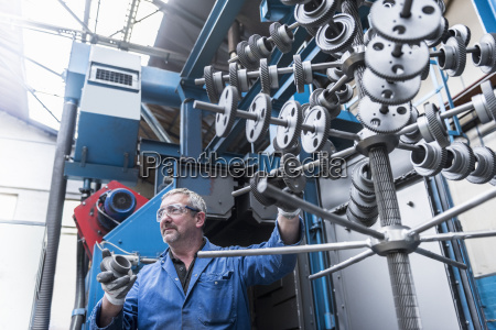 engineer with shot blasted gear wheels