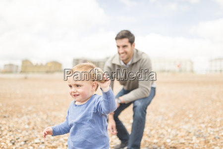 father and young son playing on