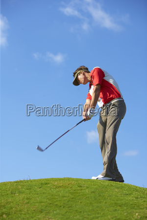 low angle view of golfer on
