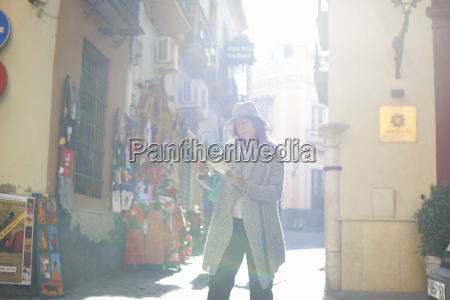 woman sightseeing reading map seville spain