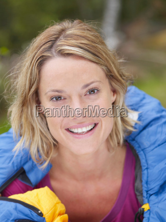 woman with sleeping bag wrapped around