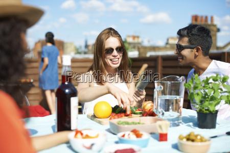adult friends preparing fresh finger food