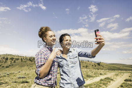 two young women taking smartphone selfie