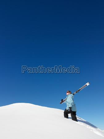 skier climbing mountain