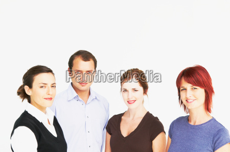four business people looking at camera