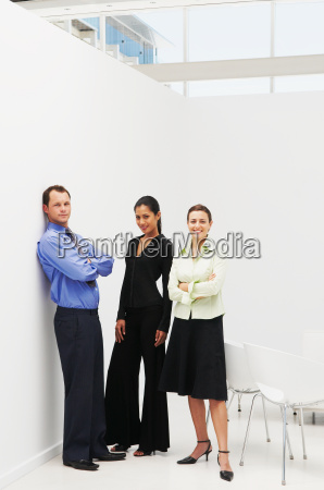 three business people standing in office