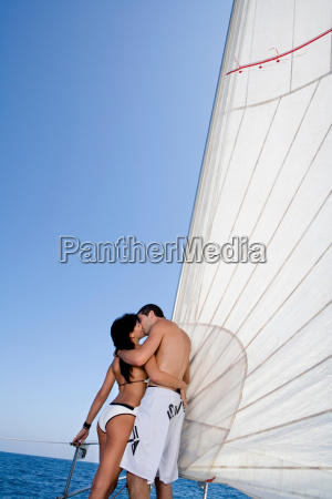 couple on sail boat kissing