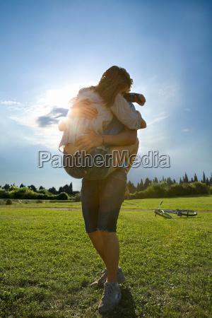 teen lovers hug in park
