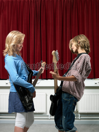 boy and girl playing guitar