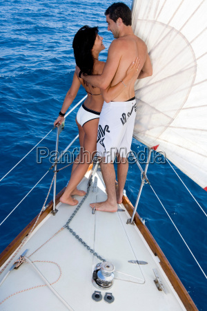 couple standing on sail boat