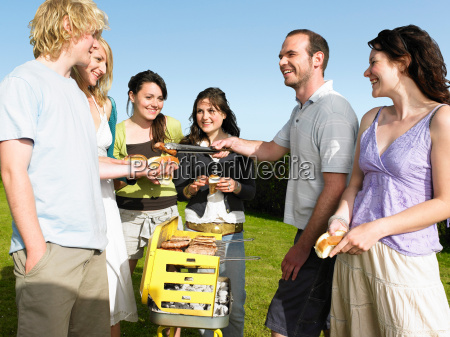 group of people around barbecue