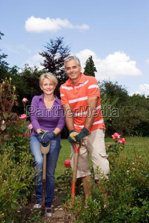portrait of couple gardeners