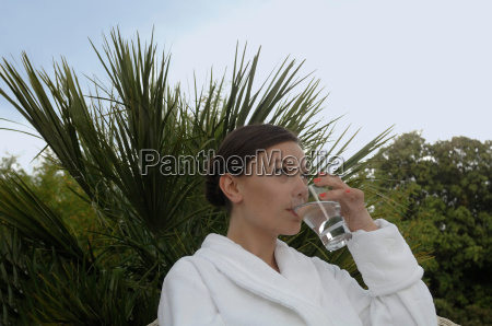woman having a drink outdoors