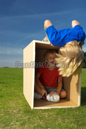 boy in box shouting