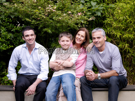 family sitting together in garden