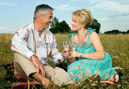 couple have a picnic in a