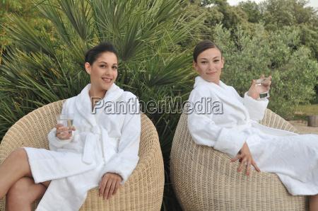 two women having a soft drink