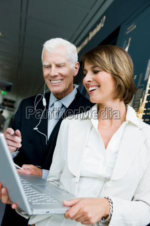 older man and woman looking at