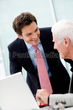 younger man talking to older man