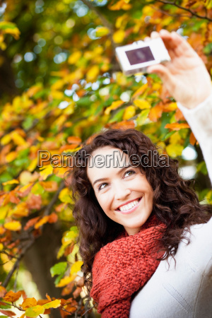 young woman taking self portrait