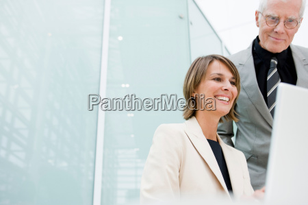 woman and older man in working