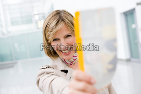 woman holding ticket smiling