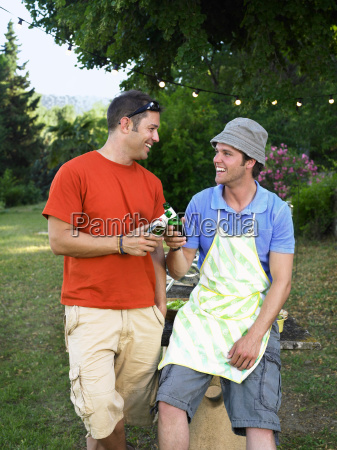 two men toasting at barbecue
