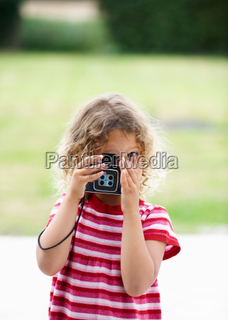young girl taking photo