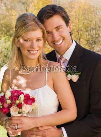 a wedding couple smiling to camera