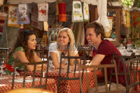 friends talking in french market cafe