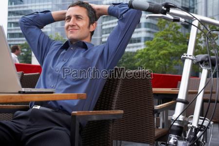 man working on laptop outside