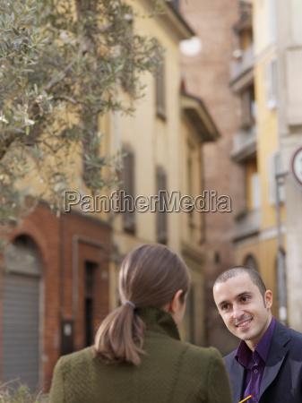 man and woman in european street