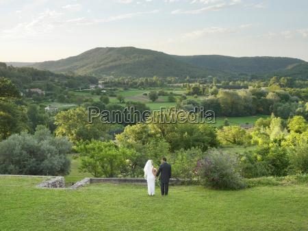 rear of wedding couple in garden