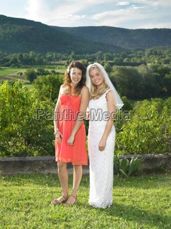 bride and bridesmaid in garden