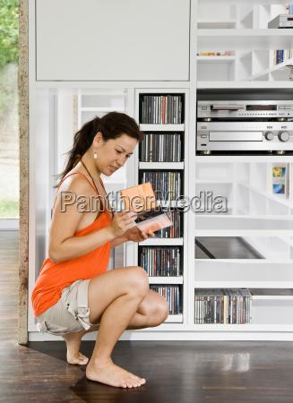 women looking over cds