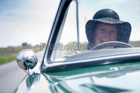 mature lady driving car