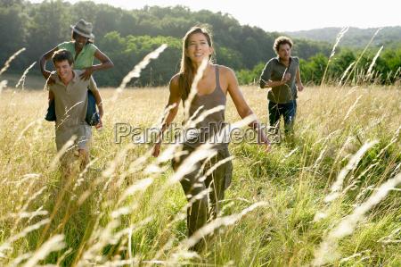 friends running in a field