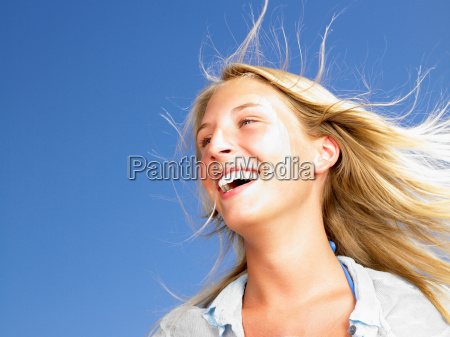 woman smiling blue sky above