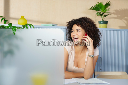 young woman on phone at desk