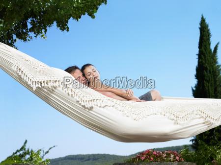 couple, relaxing, on, hammock - 18420370