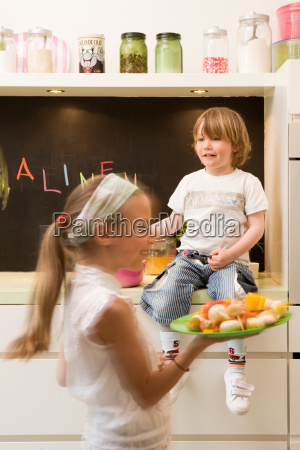 girl and boy cooking vegetables