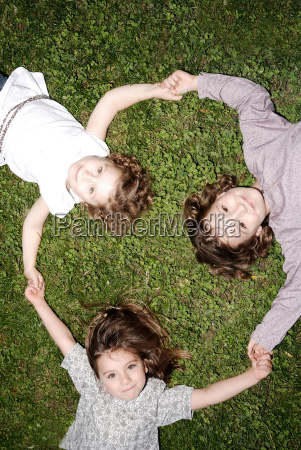 3 young girls holding hands