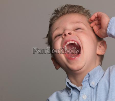boy laughing portrait close