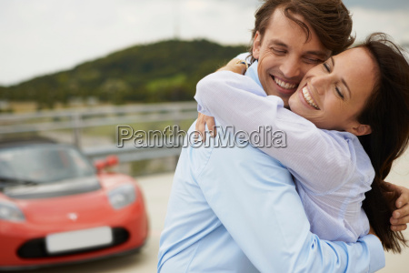 couple hugging in front of electric