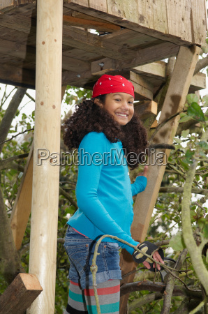 girl playing in treehouse
