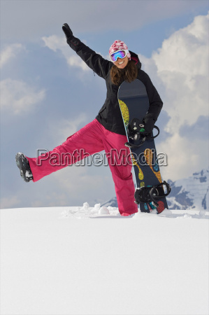 female snowboarder playing around in the