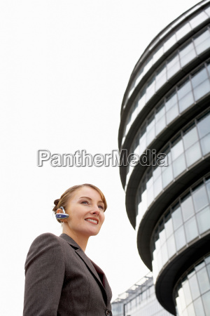 business woman using bluetooth headset
