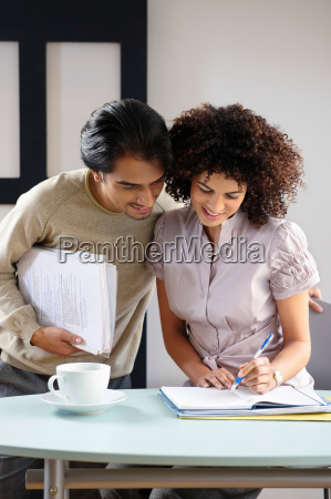 man and woman in office cafe