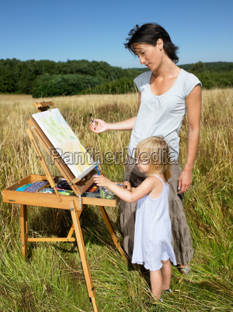 mother and daughter painting in a